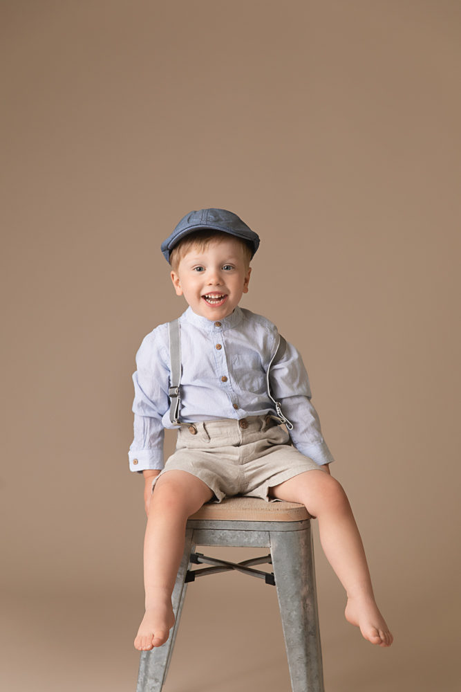 Toddler boy wearing hat